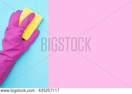 A Man In A Protective Rubber Glove Holds A Yellow Sponge. Copy Space. Cleaning Service. Place For Yo