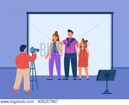 Parents And Kid Standing Together For Family Photoshoot. Photographer With Photo Camera On Tripod Ph