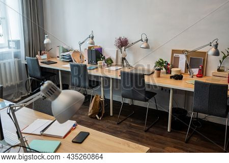 Part of contemporary office with rows of workplaces for white collar workers