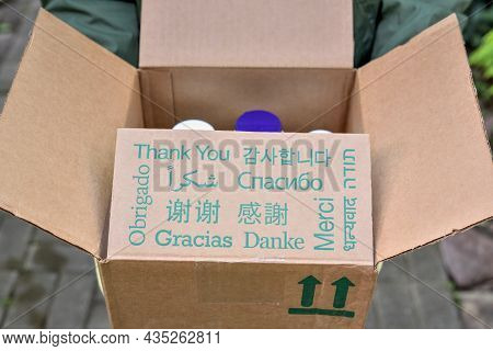 Parcel With Text Thank You In Different Languages. Thank You Inscription In Different Languages On T