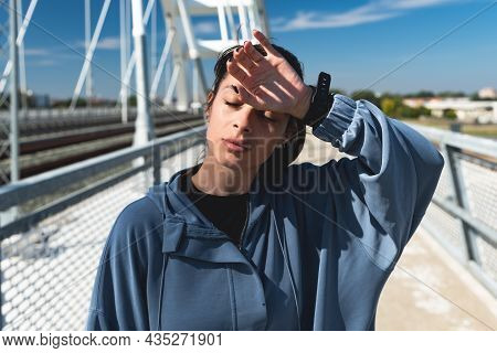 Sport, Urban Fitness And Workout Concept. Fit Female Athlete Feel Slight Fatigue After Morning Run,