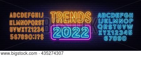 Trends 2022 Neon Sign On Brick Wall Background.
