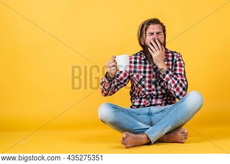Yawning Sleepy Tired Guy. He Is Taking A Coffee Break. Handsome Mature Guy Drinking From Cup. Hold C