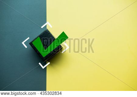 Check Mark On A Black Wooden Block. The Concept Of Choice And Making The Right Decision. Business Ma