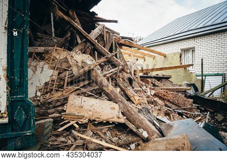 Old Wooden And Stone Ruined Building Close Up. Dismantling Of House Or After Disaster.