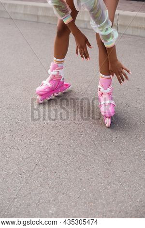 Partial View Of African American Woman Skating On Roller Skates Outside
