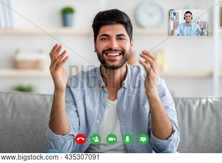 Remote Distant Communication. Young Arab Guy Having Video Online Call With Colleague, Talking And Ge