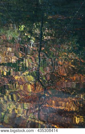 Autumn Colors Reflected On The Water. A Lake With The Reflection Of The Trees. Navarra. Spain, Europ