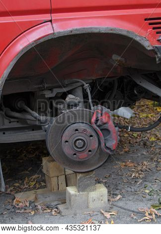 The Red Car With The Removed Wheel. Brakes On A Car Without Wheel