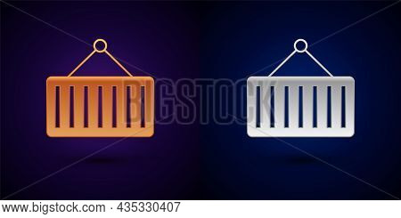 Gold And Silver Container On Crane Icon Isolated On Black Background. Crane Lifts A Container With C
