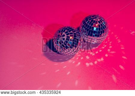 Mirror Disco Balls Over Pink Background. Party, Nightlife Concept