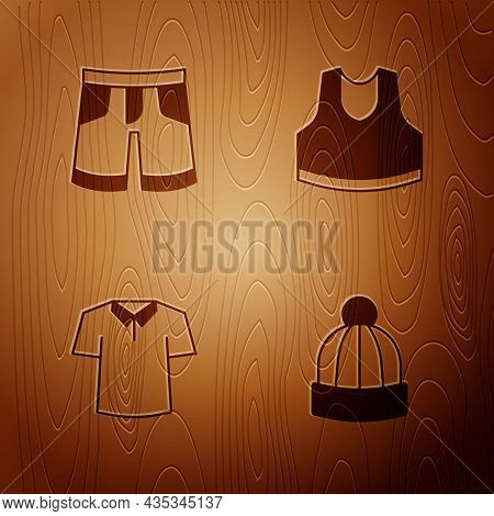 Set Winter Hat, Short Or Pants, Shirt And Undershirt On Wooden Background. Vector