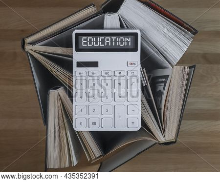 Financial Education Concept. Word On Calculator With Books On Accounting And Finance.
