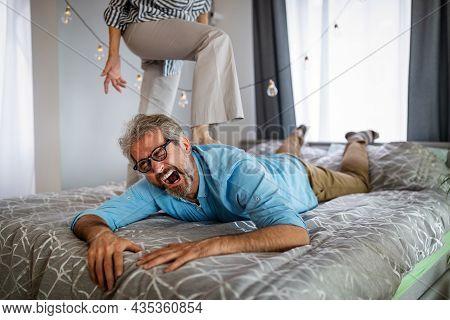 Senior Couple Having A Forplay For Bdsm, Female Dominance Sex.