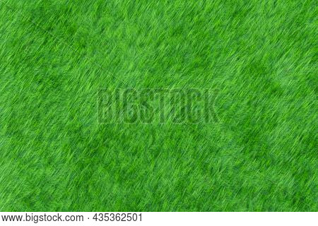 Blurred Image Of Green Grass In A Football Field, Is It Real Grass Or Fake Grass, Or Maybe A Lawn In