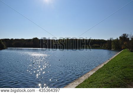 Panoramic View Of The Lake. Sun Glare On The Water Of The Lake. Ducks On The Lake.