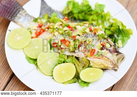 Steamed Tilapia Fish With Chili And Lime Lemon Sauce With Herb And Vegetable On Plate, Food Cooked T
