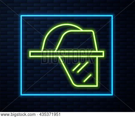 Glowing Neon Line Firefighter Helmet Or Fireman Hat Icon Isolated On Brick Wall Background. Vector