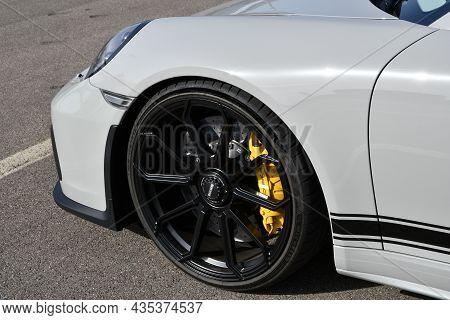 Mugello Circuit, Italy - 23 September 2021: Detail Of An Alloy Wheel Rim With Yellow Brake Caliper O