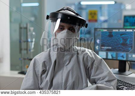 Portrait Of Scientist Woman Wearing Protective Medical Equipment Against Coronavirus Working At Viru