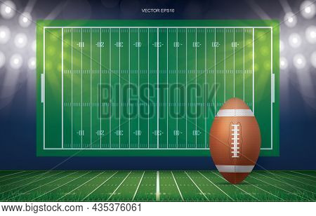 Football Ball On Football Field Stadium Background. With Perspective Line Pattern Of American Footba
