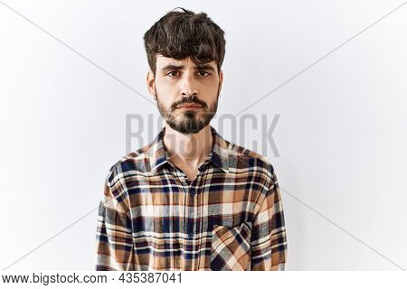 Hispanic man with beard standing over isolated background depressed and worry for distress, crying angry and afraid. sad expression.