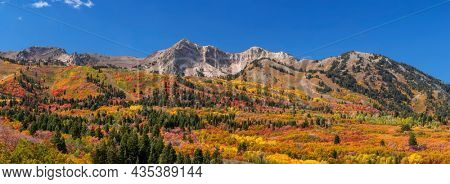Panoramic view of Snow basin landscape with bright fall foliage around Mont Ogden in Utah