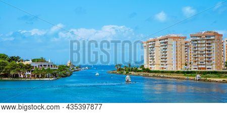 a view of the inner side of la Gola del Puerto canal, in La Manga del Mar Menor, Murcia, Spain, facing the Mar Menor lagoon, in a panoramic format to use as web banner or header