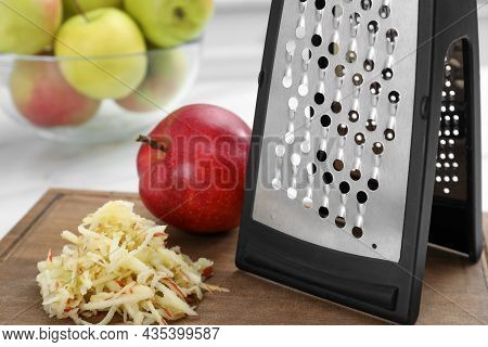 Grater And Fresh Ripe Apple On Wooden Board, Closeup