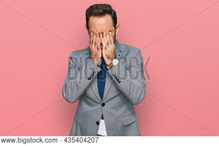 Middle age man wearing business clothes rubbing eyes for fatigue and headache, sleepy and tired expression. vision problem