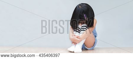 Little Girl Felt Mournful, Sitting And Hugging Knees And Bowing Nestle Her Head In Sorrow. Concept O