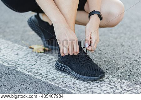 Fitness Woman Tying Shoelaces Outdoors. Tie Sneakers. Sport And Healthy Active Lifestyle Concept. Gi