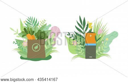 Eco Shopping Bag And Rechargeable Battery Among Green Foliage As Environmental And Ecology Protectio