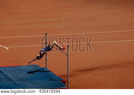 High Jump Male Athlete Jump At Athletics Competition