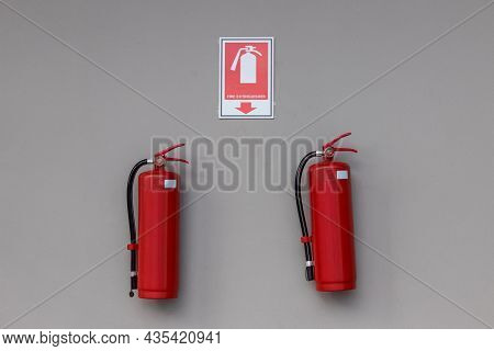 Fire Extinguisher In The Operating Department . Install A Fire Extinguisher On The Wall In Building.