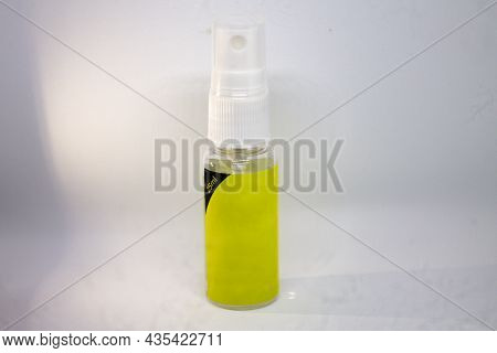 Camera Lens Cleaning Liquid In A Spray Bottle.