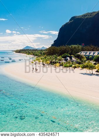 Luxury Beach With Le Morne Mountain In Mauritius. Beach With Palms And Blue Ocean. Aerial View