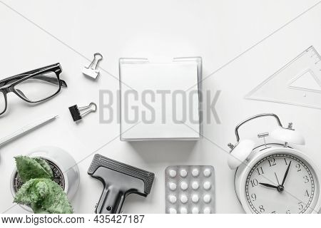 Top View Of Desktop With Blank Of Notepad, Pen, Clock And Antidepressants On White Background. Flat