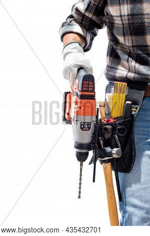 Carpenter Worker At Work Holding Rechargeable Hammer Drill, Isolated On White Background. Constructi