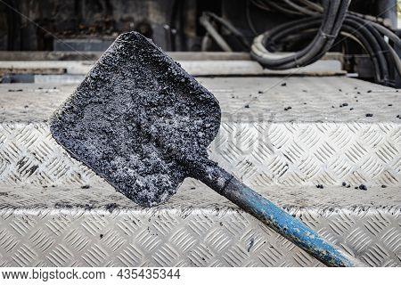 Construction Tool For Road Works. Shovel For Laying Asphalt Close-up. Asphalting Of Roads