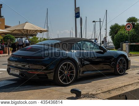 Portals Nous, Spain; October 03 2021: Black Porsche Parked In The Luxurious And Touristic Resort Of