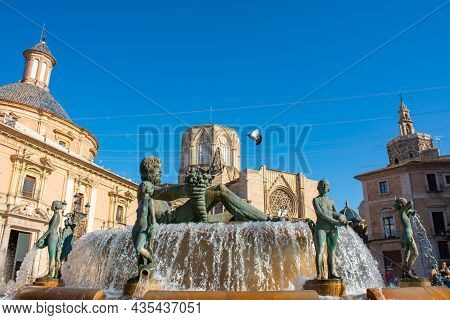 Valencia, Spain. July 7, 2021 - Square With The Fountain, The Basilica Of The Virgin, The Cathedral