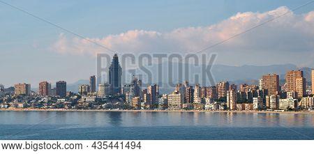 Waterside Distant Horizontal Image Of Benidorm City. Spanish Famous Touristic Resort City. Modern Sk