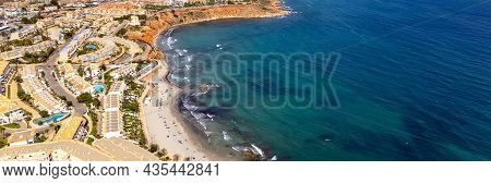 Aerial Drone Point Of View Dehesa De Campoamor On The Costa Blanca Of Spanish Tourist Resort, Sandy