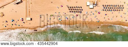 Directly Above, Drone Point Of View Turquoise Bay Green Waters Of Mediterranean Sea Deckchairs And P