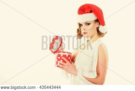 Woman Attractive Wear Sexy Dress And Christmas Santa Hat. She Got Present On Christmas. Girl Hold Po