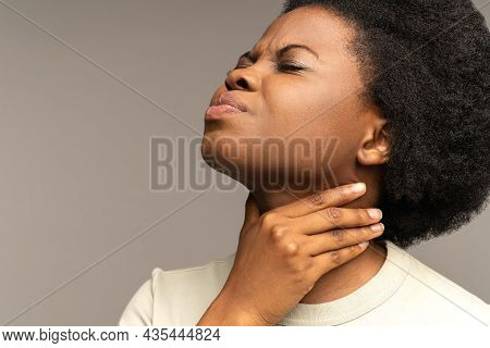 Unhealthy Woman Touch Neck Feeling Discomfort And Pain Swallowing. Sick African American Female With