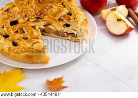 Autumn Apple Pie With Cinnamon And Red Apples