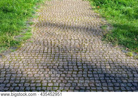 Paving Stones. Paved Road. Cobblestone Surface. Selective Focus.
