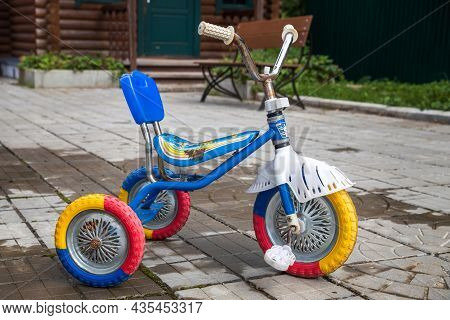 Moscow, Russia - September 5, 2021. Shabby Colorful Kids Tricycle.